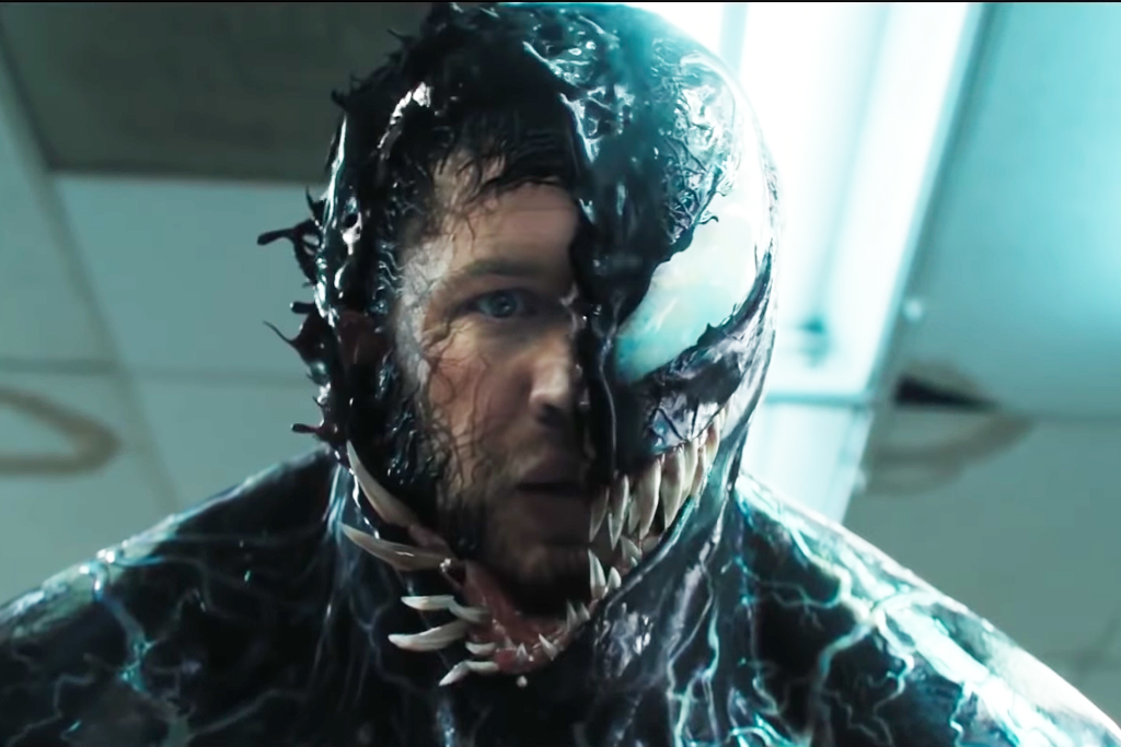Venom Chomps Heads And Battles Riot In New Trailer