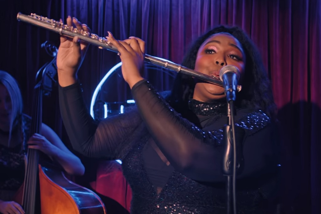 Lizzo, playing the flute in a homage to Anchorman